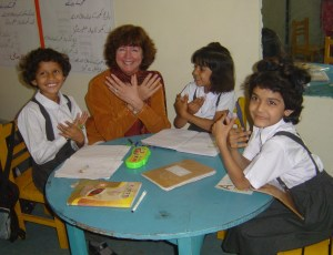 Helen playing with students